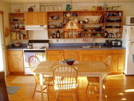 Interior view of dining and kitchen showing bright compact home